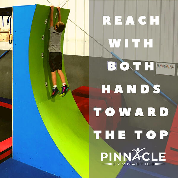Reach with both hands toward the top How to get to the top of the warped wall